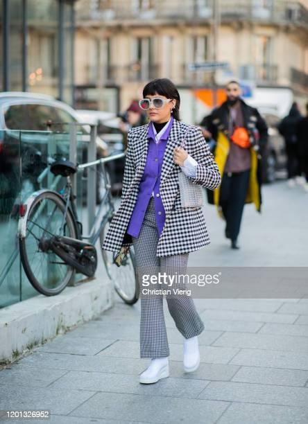 Maria Bernad seen wearing purple button shirt, white black blazer and pants outside Viktor & Rolf during Paris Fashion Week - Haute Couture...