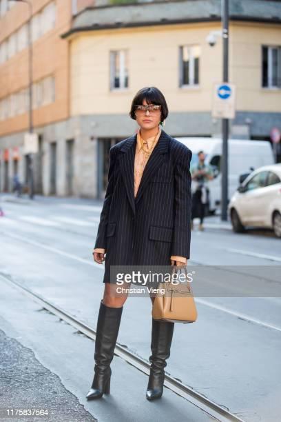 Maria Bernad seen wearing striped oversized blazer beige bag boots outside Attico during Milan Fashion Week Spring/Summer 2020 on September 19 2019...
