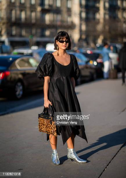 Maria Bernad wearing black dress bag with leopard animal print outside Rochas during Paris Fashion Week Womenswear Fall/Winter 2019/2020 on February...