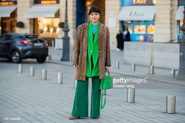 Maria Bernad wearing brown coat with snake print, green Louis Vuitton bag, green bag seen during Paris Fashion Week - Haute Couture Spring/Summer...