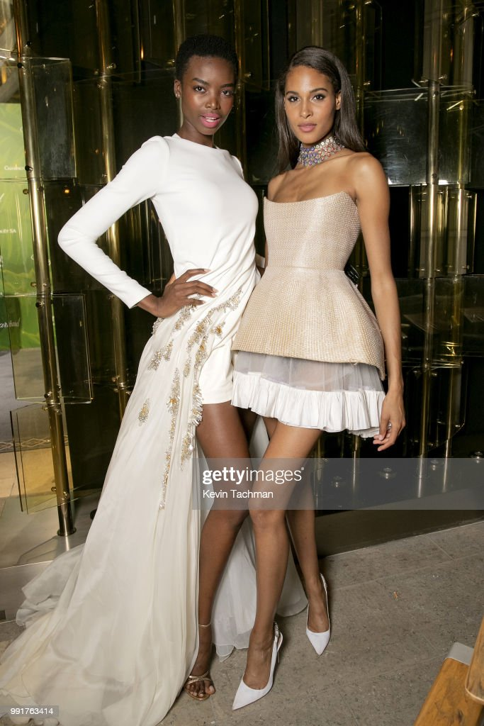 Maria Borges and Cindy Bruna attend the amfAR Paris Dinner at The Peninsula Hotel on July 4, 2018 in Paris, France.