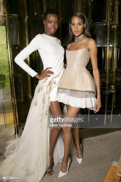 Maria Borges and Cindy Bruna attend the amfAR Paris Dinner at The Peninsula Hotel on July 4 2018 in Paris France