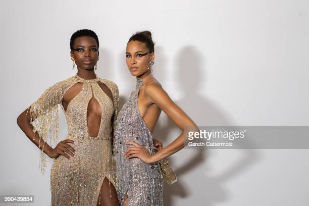 Maria Borges and Cindy Bruna backstage before the Georges Hobeika Haute Couture Fall Winter 2018/2019 show as part of Paris Fashion Week on July 2,...