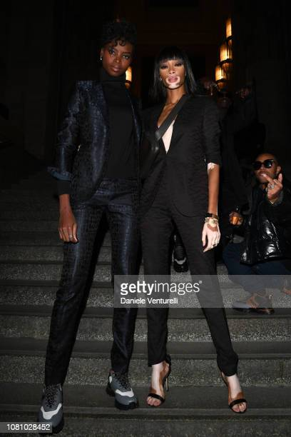 Maria Borges and Winnie Harlow attend the Ermenegildo Zegna show during Milan Menswear Fashion Week Autumn/Winter 2019/20 on January 11 2019 in Milan...