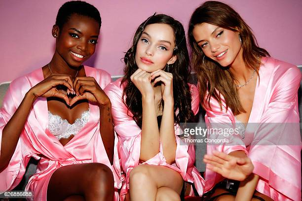 Maria Borges Luma Grothe and Valery Kaufman prepare backstage before the 2016 Victoria's Secret Fashion Show in Paris on November 30 2016 in Paris...