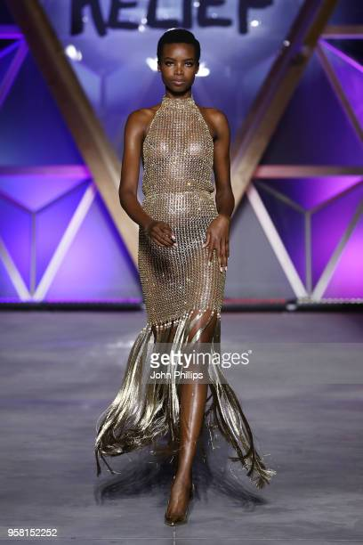 Maria Borges walks the Runway at Fashion for Relief Cannes 2018 during the 71st annual Cannes Film Festival at Aeroport Cannes Mandelieu on May 13...