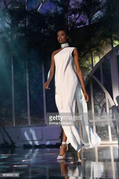 Maria Borges walks the runway at the amfAR Gala Cannes 2018 at Hotel du CapEdenRoc on May 17 2018 in Cap d'Antibes France