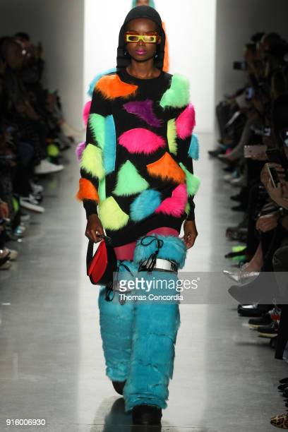 Maria Borges walks the runway wearing Jeremy Scott Fall 2018 with make up by Kabuki for MAC and hair by Eugene Souleiman for Wella at Spring Studios...