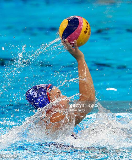 Maria Borisova of Russia passes the ball during the Women's Water Polo Bronze Medal match between Hungary and Russia on Day 14 of the Rio 2016...