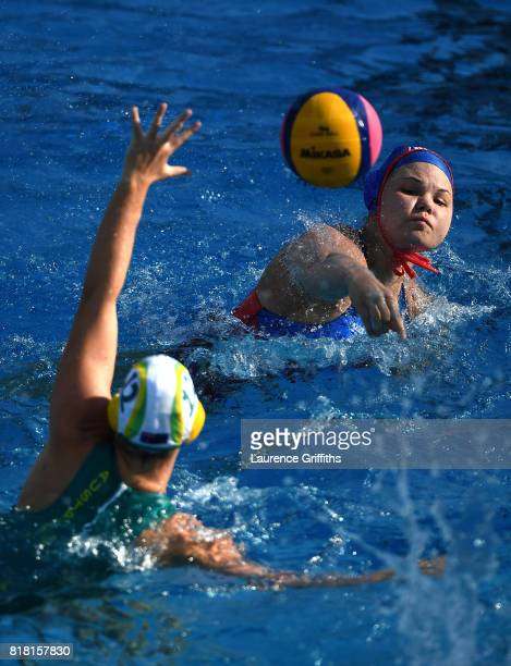 Maria Borisova of Russia shoots past Madeleine Steere of Australia to score during the Women's Water Polo Group D preliminary round match between...