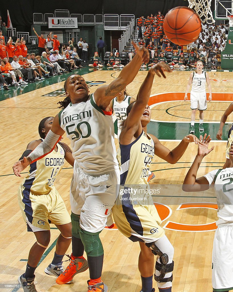 Maria Brown #50 of the Miami Hurricanes and Jasmine Blain #44 of the Georgia Tech Yellow Jackets battle for a rebound on January 17, 2013 at the BankUnited Center in Coral Gables, Florida. Miami defeated Georgia Tech 71-65.