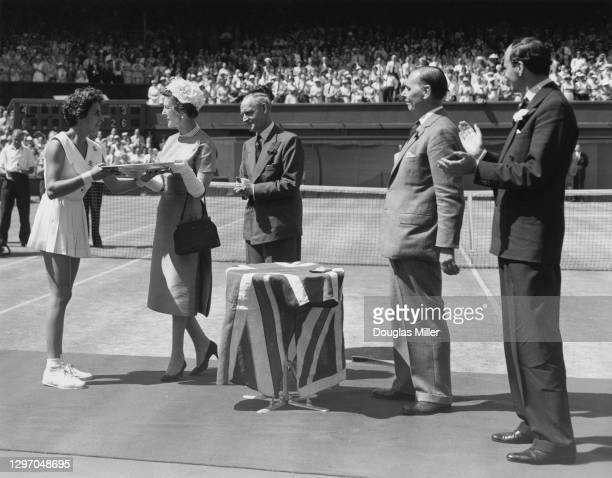 Maria Bueno of Brazil is presented with the Rosewater Plate by Princess Marina the Duchess of Kent after defeating Darlene Hard of the United States...