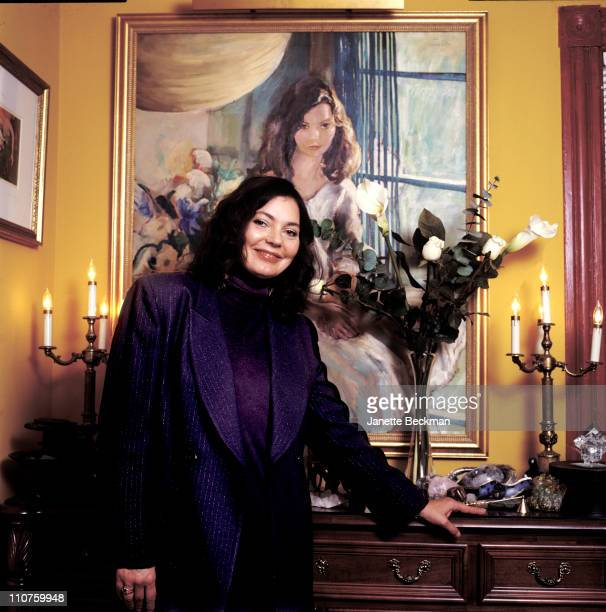 Maria Burton the adopted daughter of Elizabeth Taylor and Richard Burton at home in front of a painting of Elizabeth Taylor New Jersey 2003