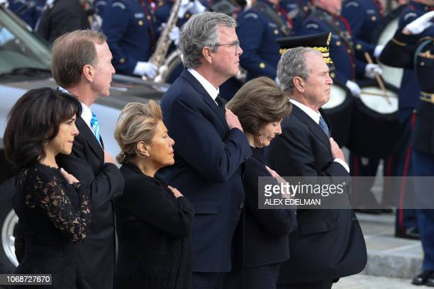 TOPSHOT Maria Bush Neil Bush Columba Bush former Florida Governor Jeb Bush former First Lady Laura Bush and former US President George W Bush arrive...