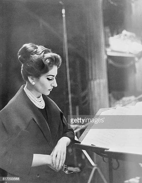 Maria Callas, famed soprano, studying a score. Half length profile.