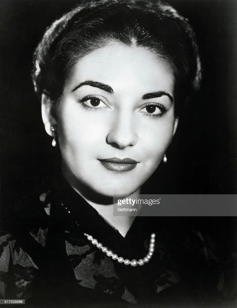 Maria Callas, renowned soprano, shown in a close-up. Callas is wearing a dark blouse and a single strand of pearls. Undated photograph.
