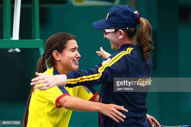 Maria Camila Osorio of Colombia celebrates with Catalina Castano Captain of Colombia during the first day of the Tennis Fed Cup American Zone Group 1...