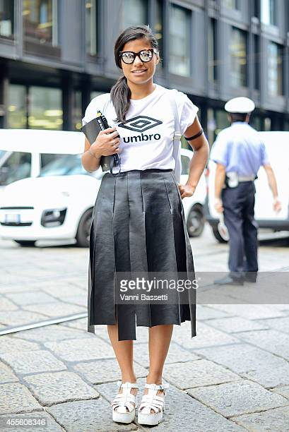 Maria Campadello poses wearing an Umbro tshirt Spektre sunglasses Asos bad and Windsor Smith shoes on September 17 2014 in Milan Italy