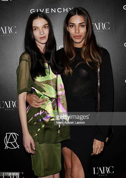 Maria Carla Boscono and guest attend the Givenchy Menswear Spring/Summer 2012 show as part of Paris Fashion Week at L'Arc on June 24, 2011 in Paris,...