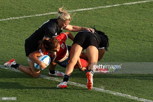 Maria Casado of Spain dives to score a try during a Women's Pool B rugby match between New Zealand and Spain on Day 1 of the Rio 2016 Olympic Games...