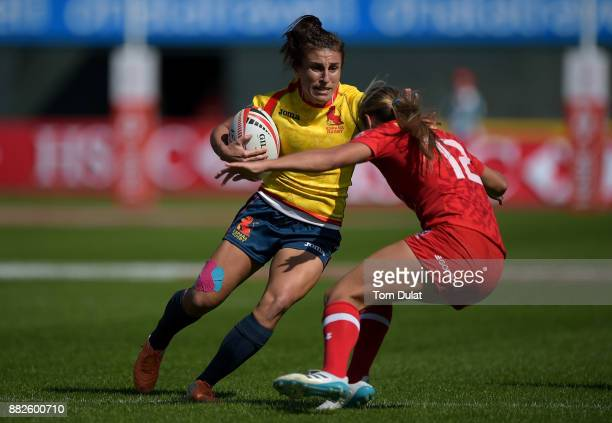 Maria Casado of Spain is tacked by Megan Lukan of Canada during Day One of the Emirates Dubai Rugby Sevens HSBC Sevens World Series match between...