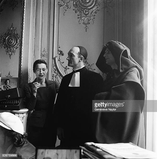 Maria Casares stands by two actors wearing costumes designed by Elsa Schiaparelli for a production at the Comedie Francaise