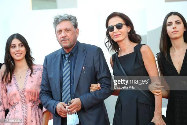 """Maria Castellitto, Sergio Castellitto, Margaret Mazzantini and Anna Castellitto walk the red carpet ahead of the movie """"I Predatori"""" at the 77th..."""