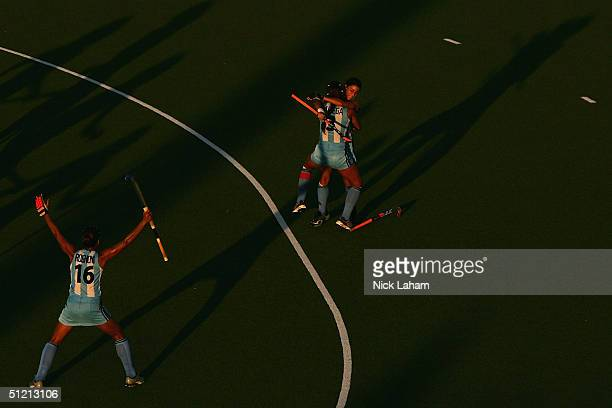 Maria Cecilia Rognomi Mariana Gonzalez Oliva and Maria Magdalena Aicega of Argentina celebrate after a goal in the women's field hockey semifinals...