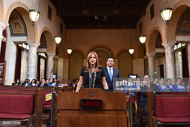 Maria Celeste Arraras and Councilman Jose Huizar speak at The City of Los Angeles Honors Maria Celeste Arraras at Los Angeles City Hall on May 24...