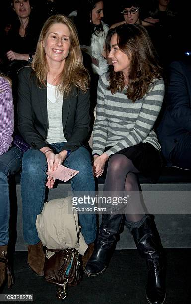 Maria Chavarri and guest attend the TCN fashion show during the Cibeles Madrid Fashion Week A/W 2011 at Ifema on February 21 2011 in Madrid Spain