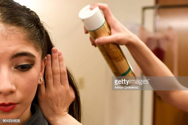 Maria Chavez gets her hair done by teacher Marta Katz during the 2018 Youth America Grand Prix semifinals at the University of Denver's Newman Center...