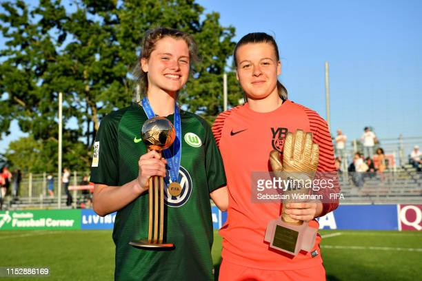 Maria Christina Lange of VFL Wolfsburg is presented with the Best Player trophy and Saskia Burki of BSC Young Boys Bern is presented with the Best...
