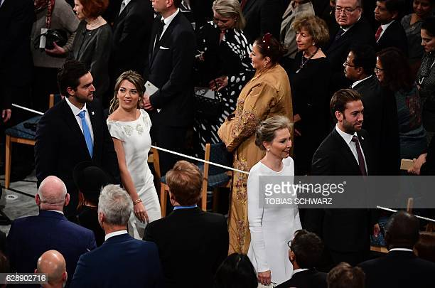 Maria Clemencia Rodriguez wife of Colombian President Juan Manuel Santos and their children Maria Antonia Santos and Martin Santos attend the award...