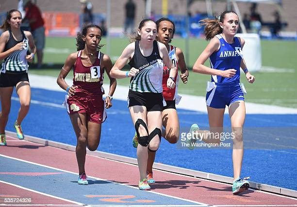 Maria Coffin of Annapolis makes her move for the lead against Abigail Green of Walter Johnson for the win in the 4A 1600 meter final during the...