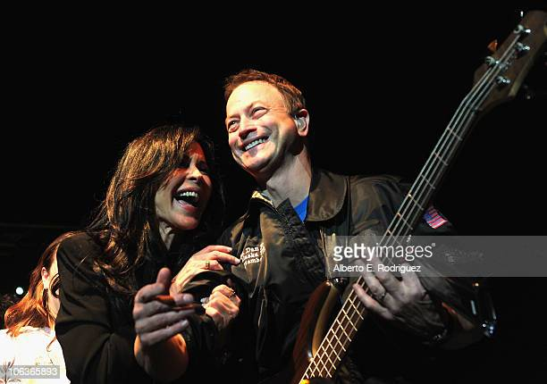 Maria Conchita Alonso actor Gary Sinise the Lt Dan Band perform at the 6th annual CSI NY midseason bash on October 29 2010 in Studio City California