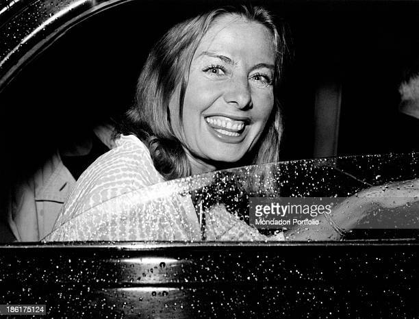 Maria Cristina Vettore Austin looking out of a car window and smiling Maria is the American tycoon Henry Ford II's partner 1963