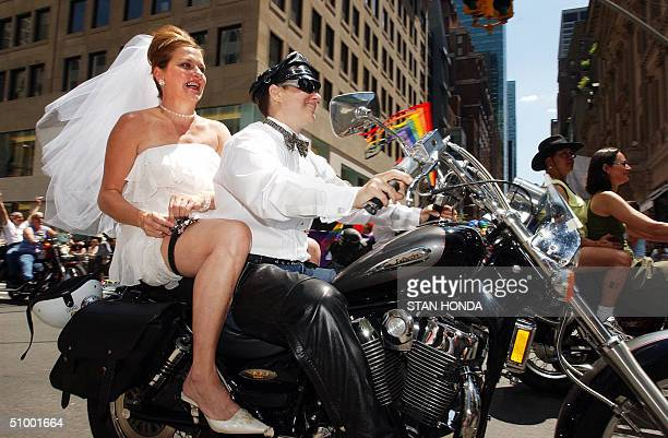 Maria Cullati adjusts her garter strap as she rides with her partner Ronnie Cohen on a motorcycle during the 35th Annual Lesbian Gay Bisexual...