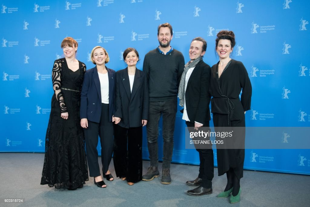 Maria Dahlin, Danish actress Alba August, Danish film director Pernille Fischer Christensen, Norwegian actor Henrik Rafaelsen, Danish author and Screenwriter Kim Fupz Aakeson and Anna Anthony pose during the photo call for the film 'Becoming Astrid' (Unga Astrid) presented in the 'Berlinale special gala' category during the 68th edition of the Berlinale film festival in Berlin on February 21, 2018. / AFP PHOTO / Stefanie Loos