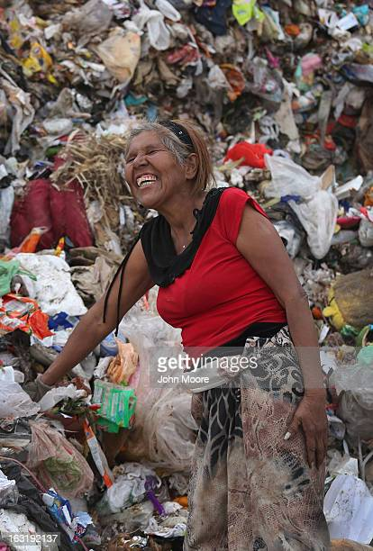 Maria de Jesus laughs with friends while working at the Tirabichi garbage dump on March 5, 2013 in Nogales, Mexico. About 30 families, including...