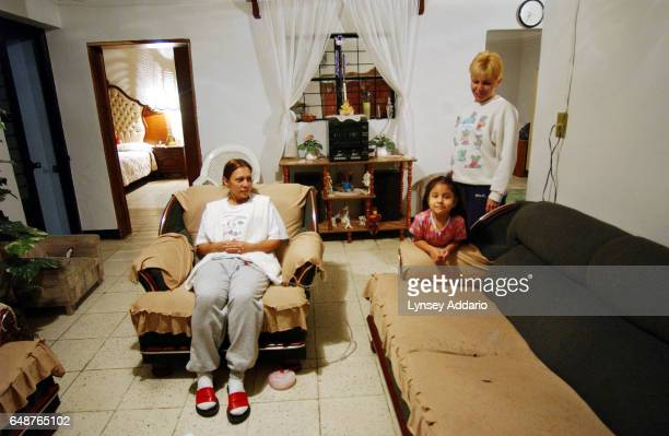 Maria de Jesus Lopez left sits in her home with her niece Linette Carillo Lopez and her sister Maria Concepcion Lopez two days after having a...