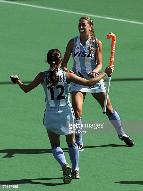 Maria de la Paz Hernandez of Argentina celebrates with Mariana Gonzalez after their team scored a goal in the third and fourth place match against...