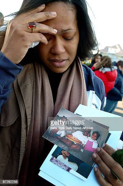 Maria DeJesus grieves for her lost husband Angel Celestino during a memorial service this morning on the fourth anniversary of the crash of American...