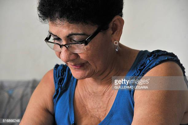 """Maria del Carmen Bonilla, who lost two brothers and a nephew, """"disappeared"""" during the armed conflict in Colombia, gestures at her home in..."""