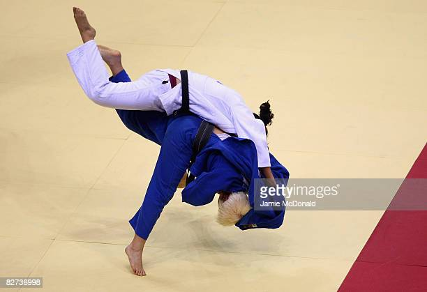 Maria del Carmen Herrera of Spain competes in the Judo -70kg Final match against Lenia Ruvalcaba of Mexico at the Beijing Workers' Gymnasium during...