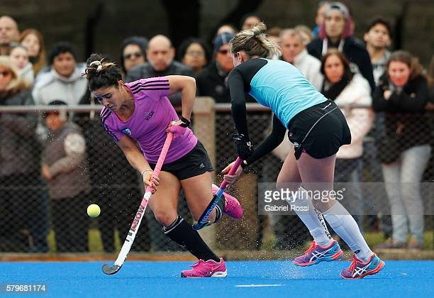 Maria del Pilar Romang of Argentina fights for the ball with Anita McLaren of New Zealand during an International Friendly match between Argentina...