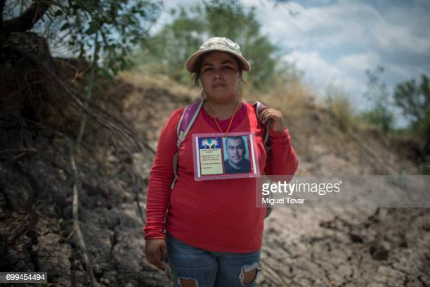 Maria del Rocio Hernandez in the search for her missing brother poses for a picture near the site where a clandestine grave was found on June 19 2017...