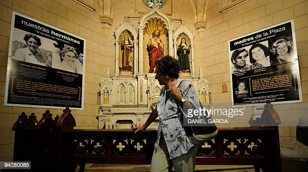 Maria del Rosario de Cerruti observes in the Santa cruz church on November 16 the posters of her friends who were disappeared and killed during the...