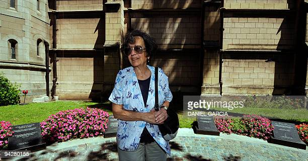Maria del Rosario de Cerruti poses in front of the Santa Cruz church on November 16 2009 next to the tombs of some victims Twelve people known as the...
