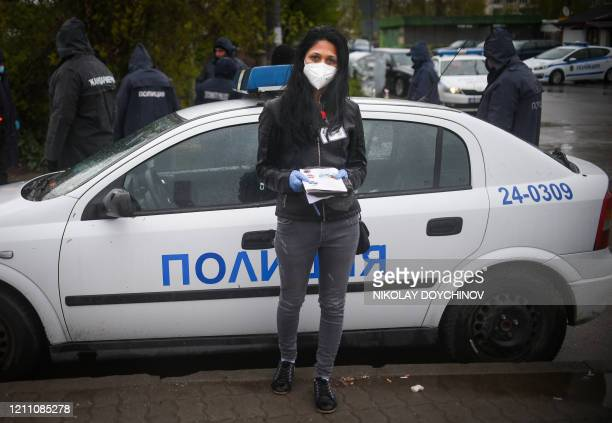 Maria Dimitrova a Roma Health mediator poses for a picture in front of a police check point at the entrance of Fakulteta the biggest Romapopulated...