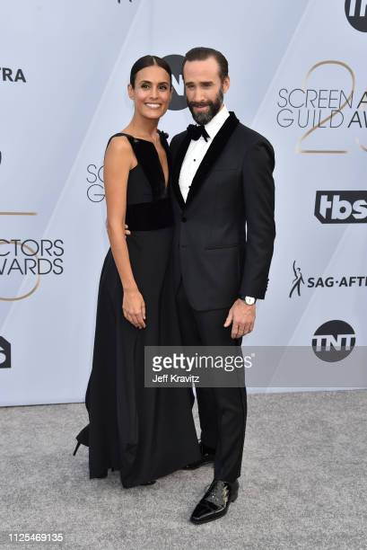Maria Dolores Dieguez and Joseph Fiennes attend the 25th Annual Screen Actors Guild Awards at The Shrine Auditorium on January 27 2019 in Los Angeles...